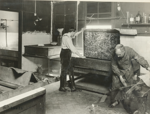 Black and white photograph of two French cartographers making a map of Le Bonhomme