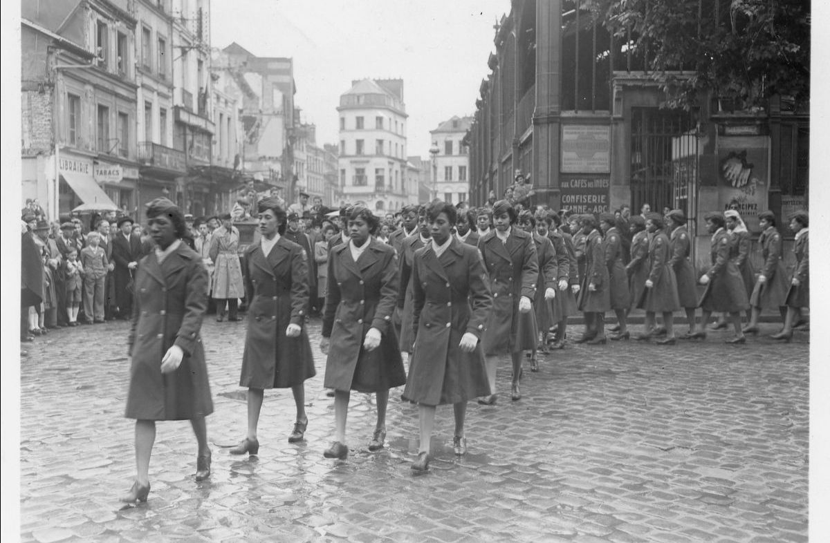 Black and white photograph of women from the WAC battalion during a parade in Rouen, France