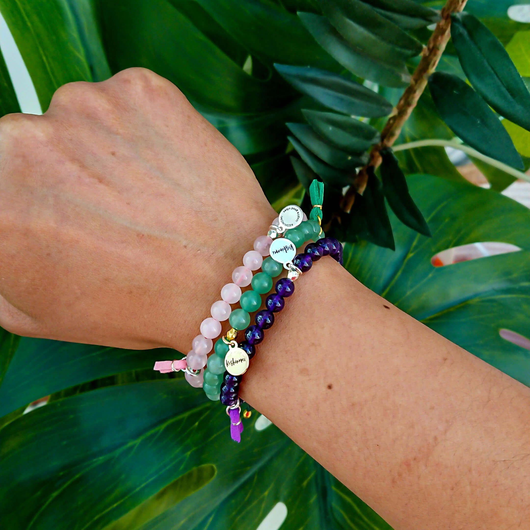 stack of gemstone bracelets