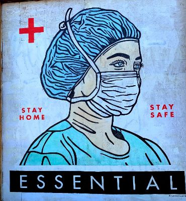 Artwork of essential worker (nurse) with mask that says Stay Home / Stay Safe
