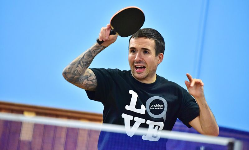 Will Bayley playing table tennis wearing a black BTTC tshirt