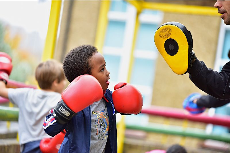 Young boy with boxing gloves on