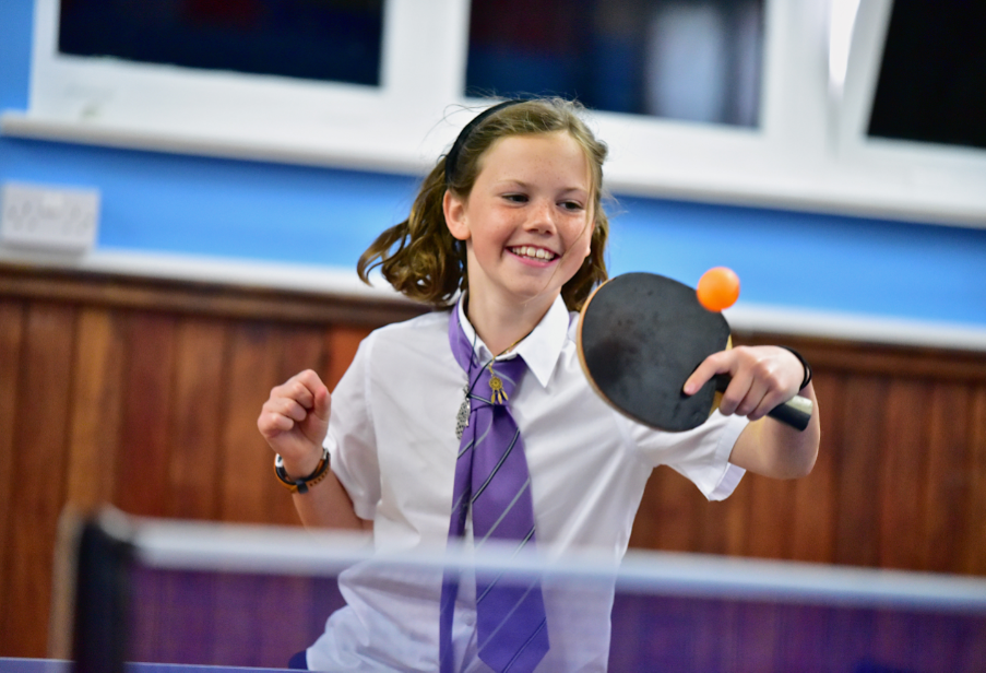 Young girl playing table tennis