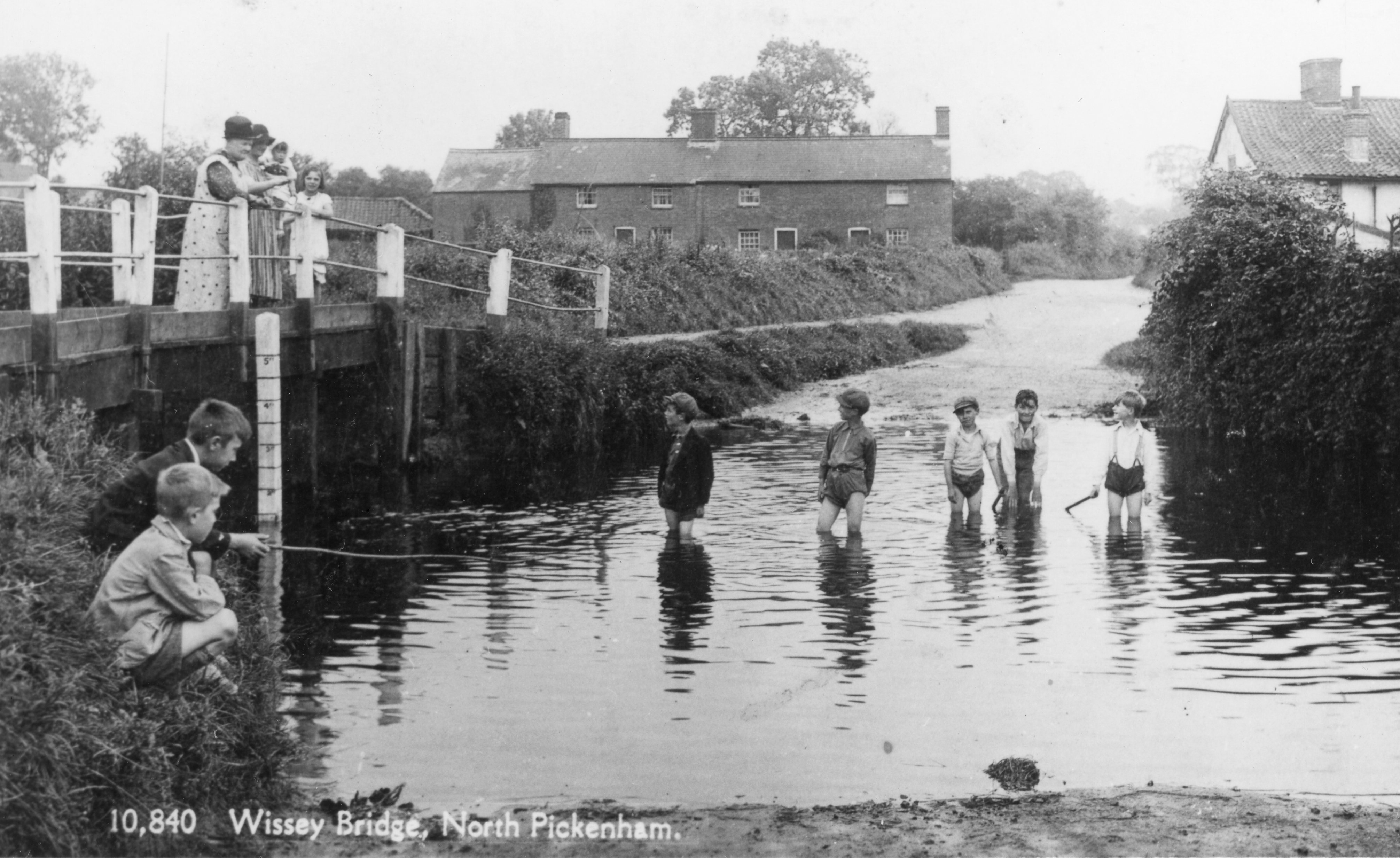 Children paddling in a ford