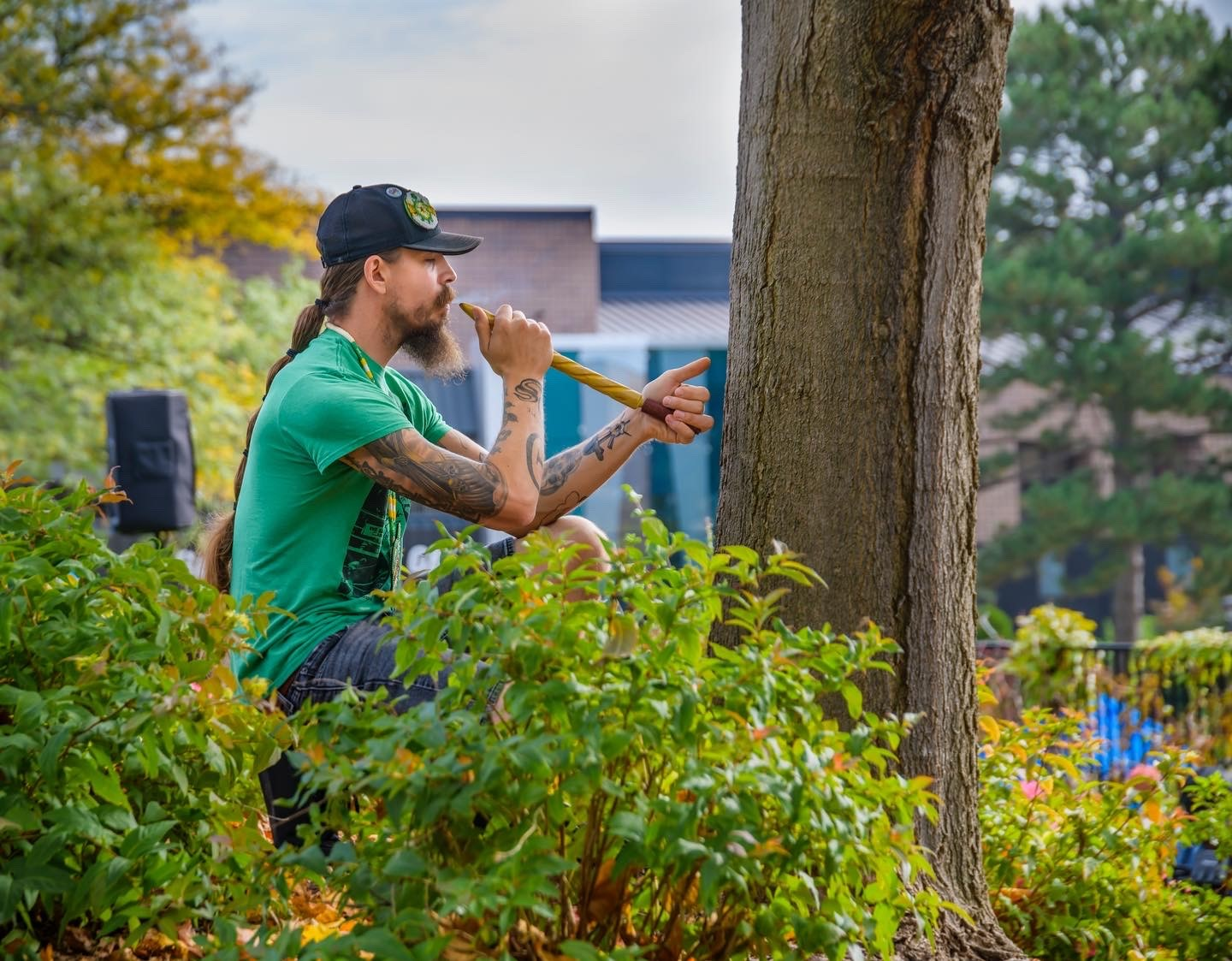 A man near the dedicated tree at Indigenous Peoples' Day in 2021.
