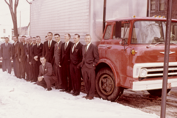 IMG #016 - President Gannon with others outside by large truck