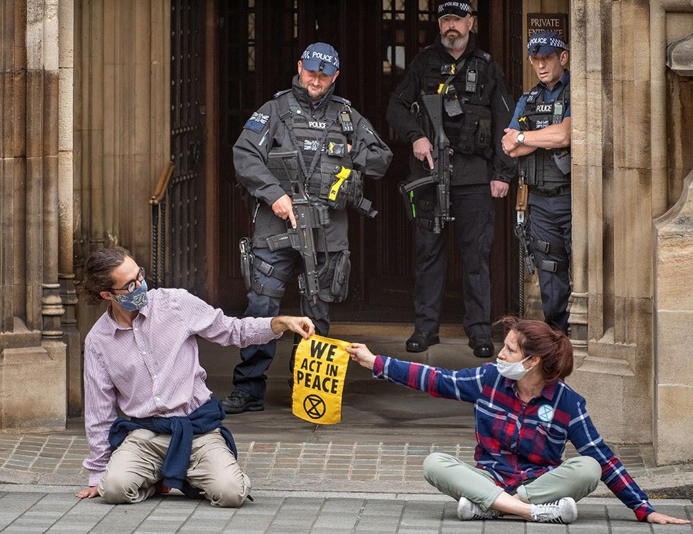 Protestors glued in front of Lloyds. XR. Gareth Morris