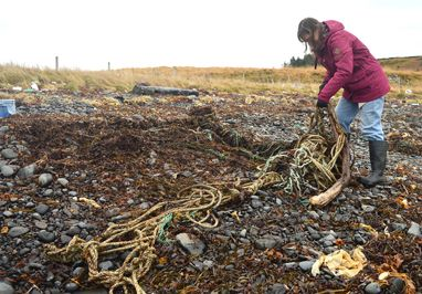 Rebecca collecting rope
