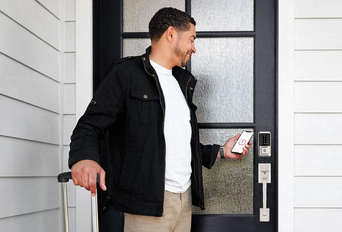 Man unlocking door with smartphone