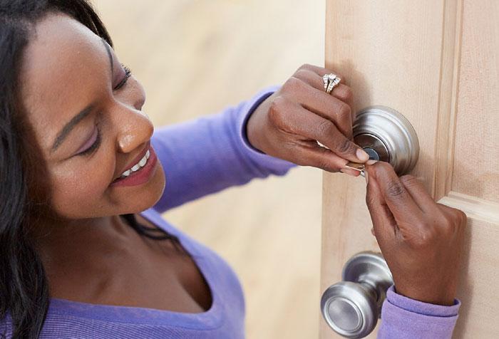 Lady rekeying door lock