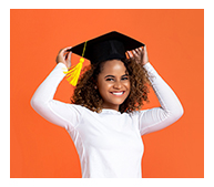teen girl putting on graduation cap
