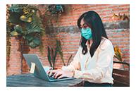 woman using laptop outside