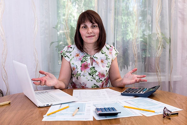 woman working taxes at dining room table