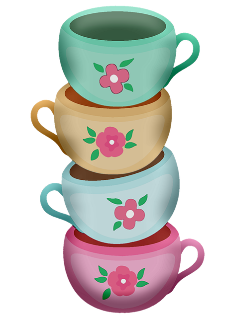 Stack of 4 different colored tea cups.