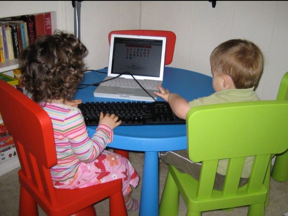 Two kids on a laptop