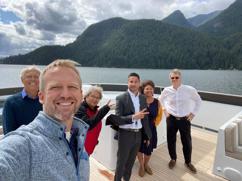 Image: MLA Glumac with MLA's Finn Donnelly and Rankin, and members of the Tsleil-Waututh nation on board a boat in Indian Arm.
