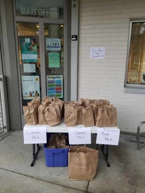 Photo of the table set up in front of the Moorlands Elementary main office where people could come and pick up a to-go breakfast bag.