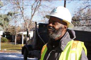Reggie Upson- dressed in denver water safety vest and white hard helmet.