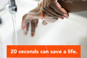 Handwashing at a sink. Message: 20 seconds can save a life.