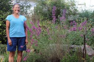 women standing by her garden