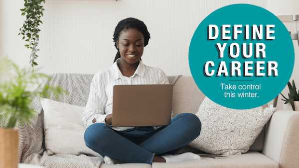 Image of a woman sitting on a sofa with a laption and the words 'Define your career - take control this winter'