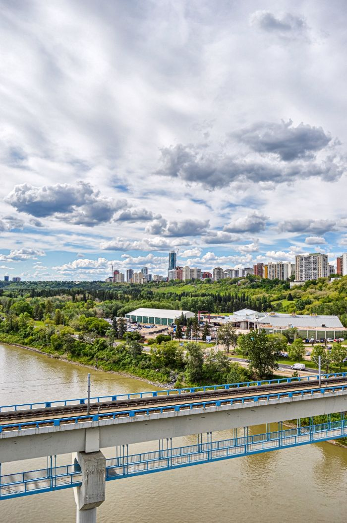A photo of the North Saskatchewan River and the streetcar bridge, with the Edmonton skyline in the distance.