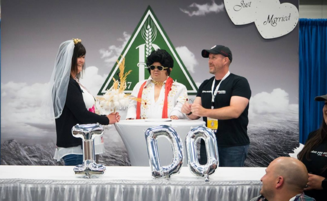 "Elvis"" officiates a wedding at a previous Edmonton Craft Beer Festival."