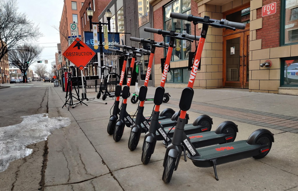 The newest flock to Edmonton's e-scooter family is Spin. You can find them all over Old Strathcona and downtown. (Mack Male)