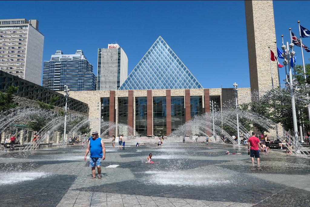 Edmontonians cool off at City Hall during one of the city's heatwaves during the summer of 2021.