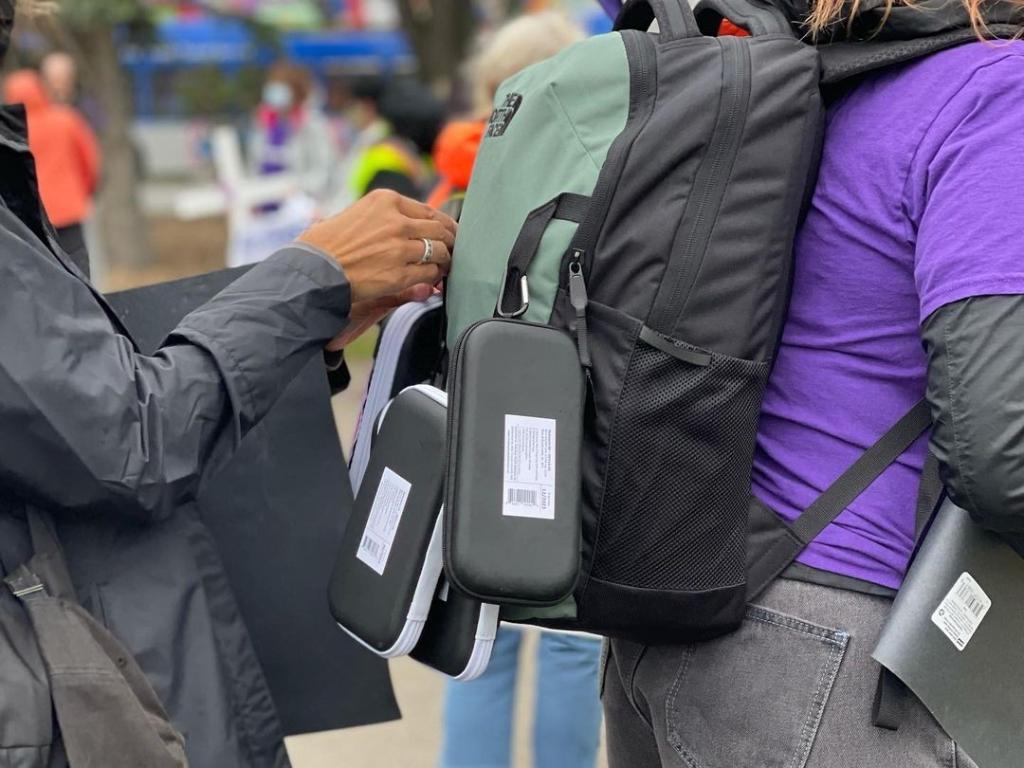 A photo of naloxone kits on a backpack.