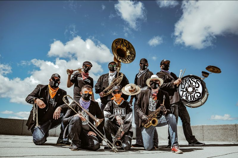 A collection of Brasstactics band members holding instruments