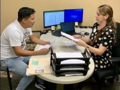 Loan officer talks to a potential home buyer at Jax Metro, a division of Self-Help CU in Jacksonville, FL
