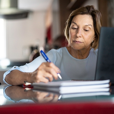 Image of a woman taking notes