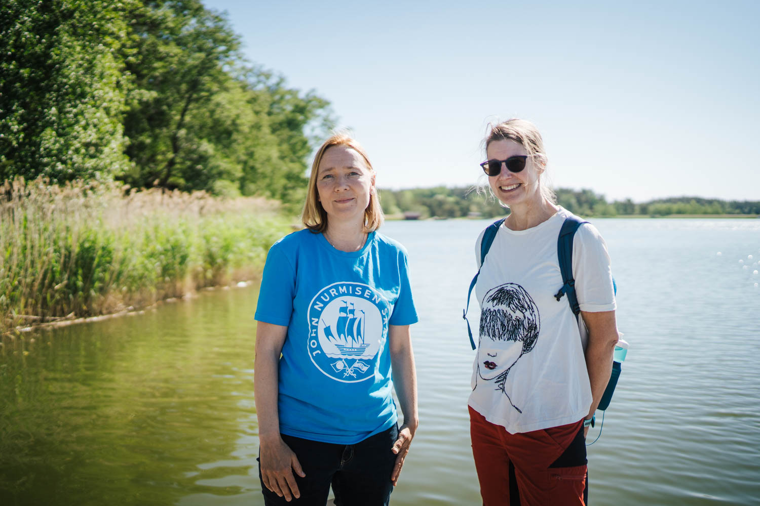 Marjukka Porvari from John Nurminen Foundation and Irma Puttonen from the Centre for Economic Development, Transport and the Environment for Southwest Finland standing on a dock, smiling.