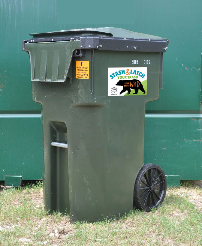 sticker in action on bear-resistant trash can