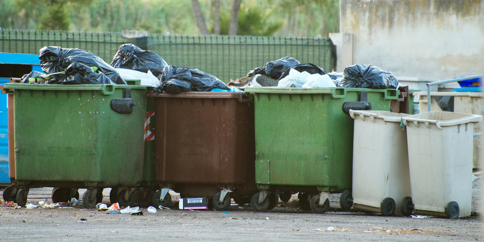 overflowing dumpsters (photo)