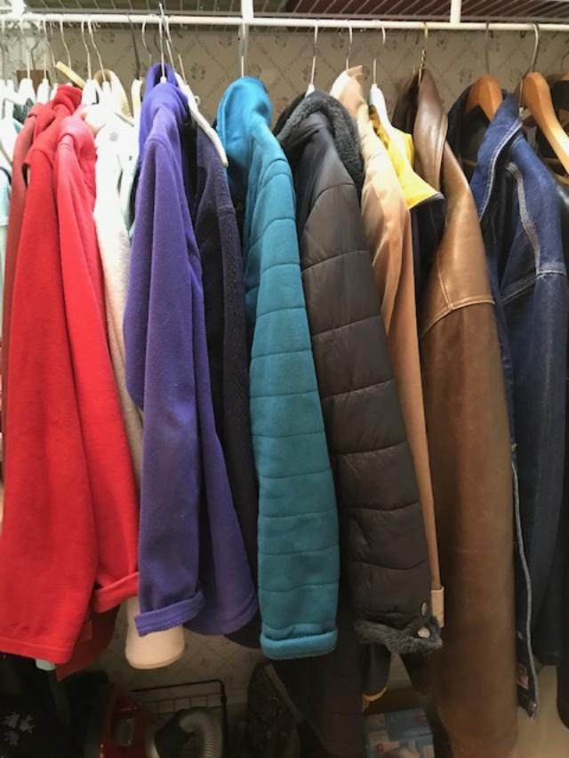 Jackets hanging in the closet