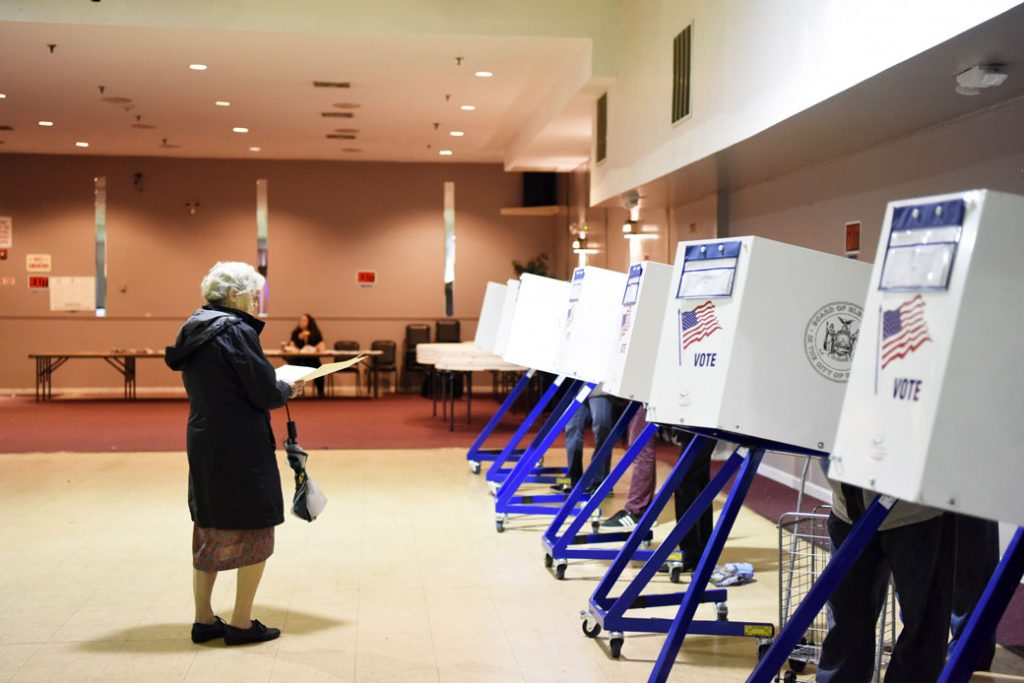 A woman standing at the polls