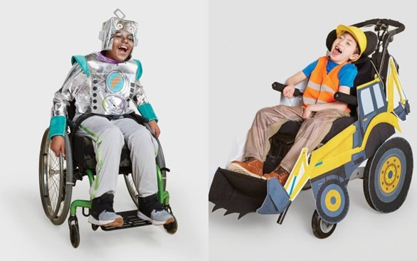 Two children in costumes that incorporate their wheelchairs. One is a robot and the other is a construction worker.
