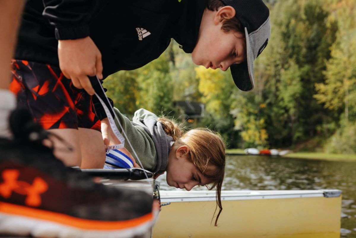 Young water rangers collect water samples from Seymour Lake near Smithers, B.C.