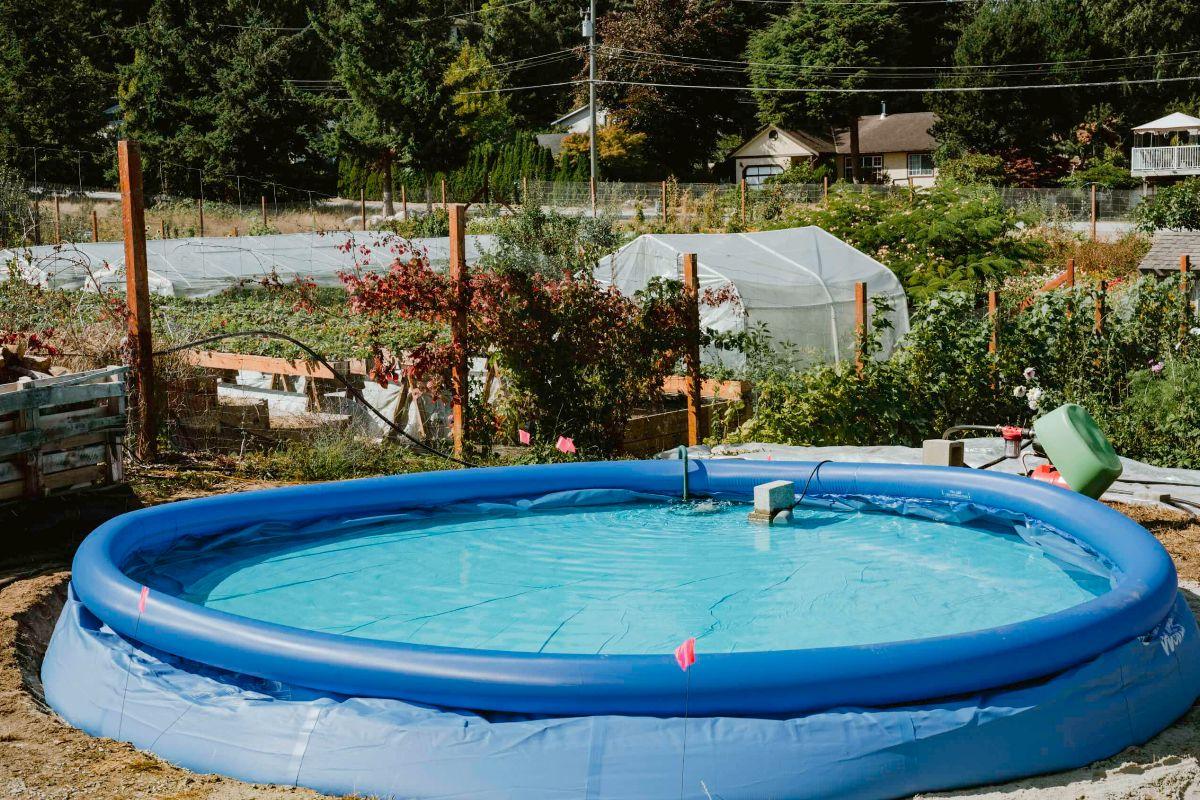 kiddie pool full of water by garden