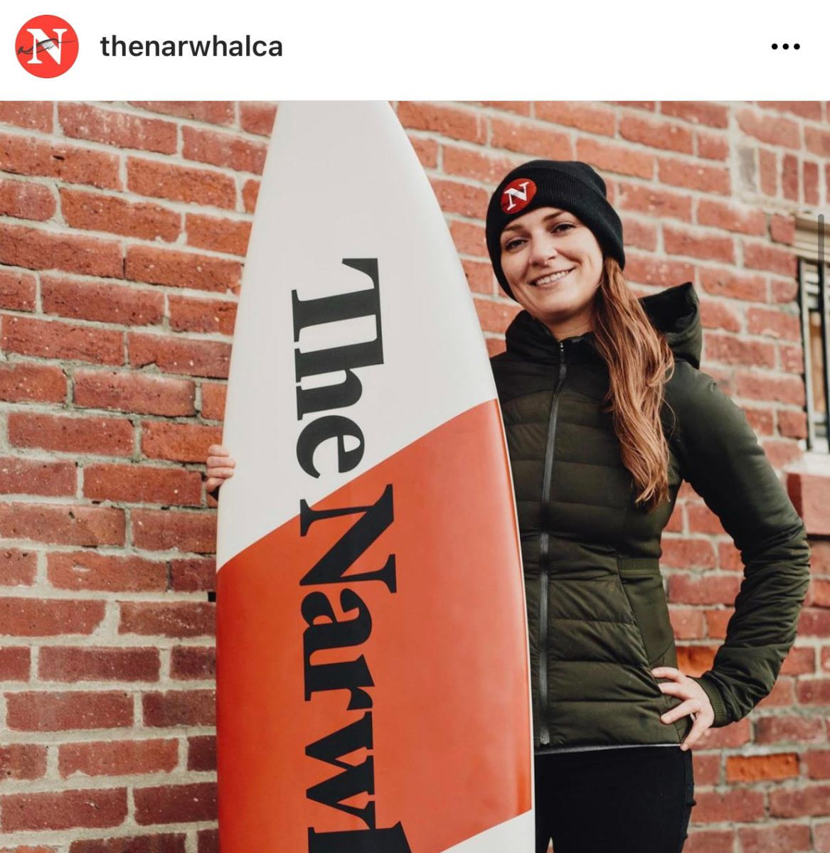 Instagram screengrab The Narwhal's editor-in-chief Emma Gilchrist holding surfboard