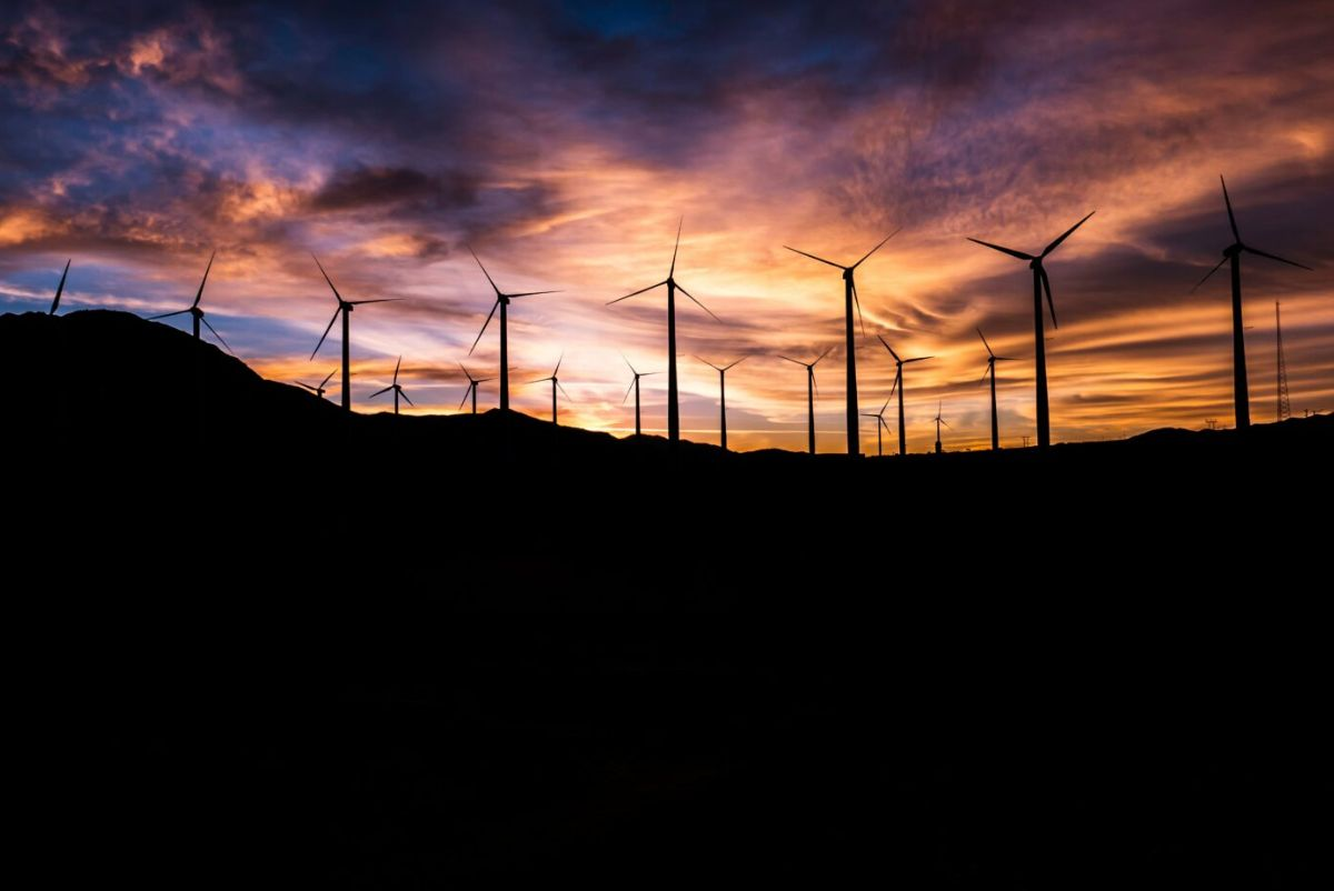 windmills on a hill at sunset