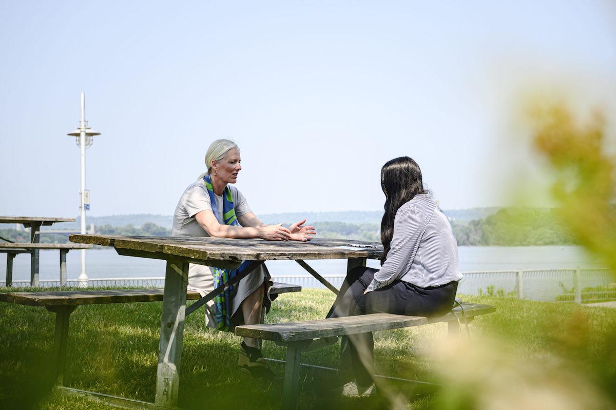 Catherine McKenna (left) chats with reporter Fatima Syed. Photo: Christopher Katsarov Luna
