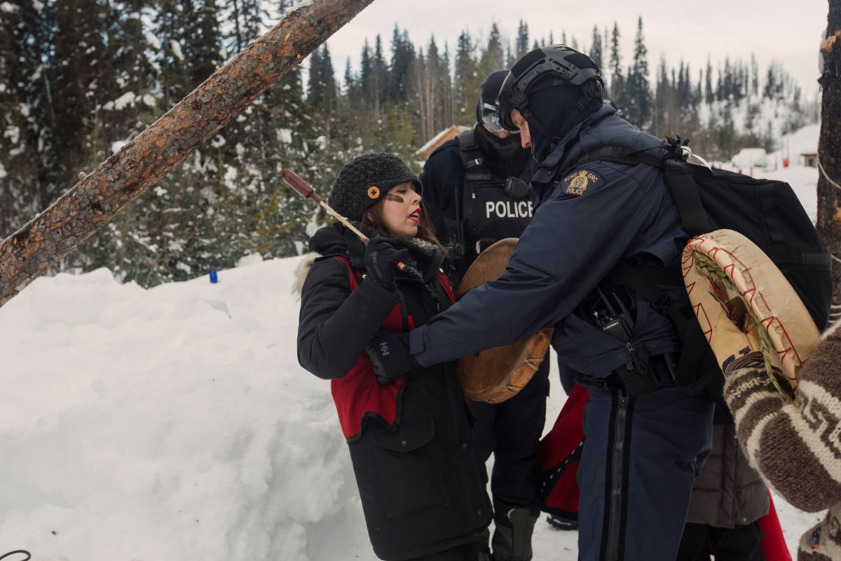 Karla Tait, a psychologist and director of clinical services for the Unist'ot'en Healing Centre, is arrested by RCMP officers on Feb. 10, 2020.