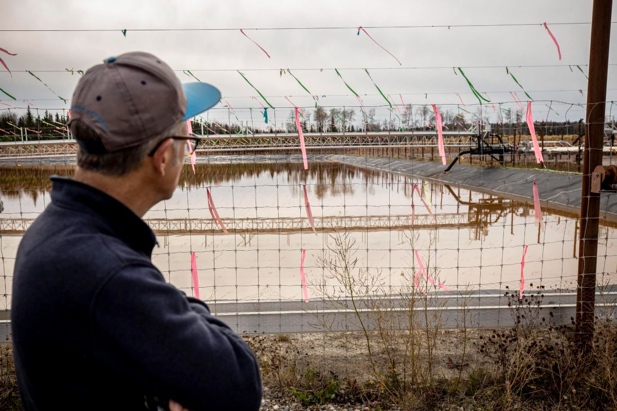 Researcher and journalist Ben Parfitt looks out at a fracking wastewater pit