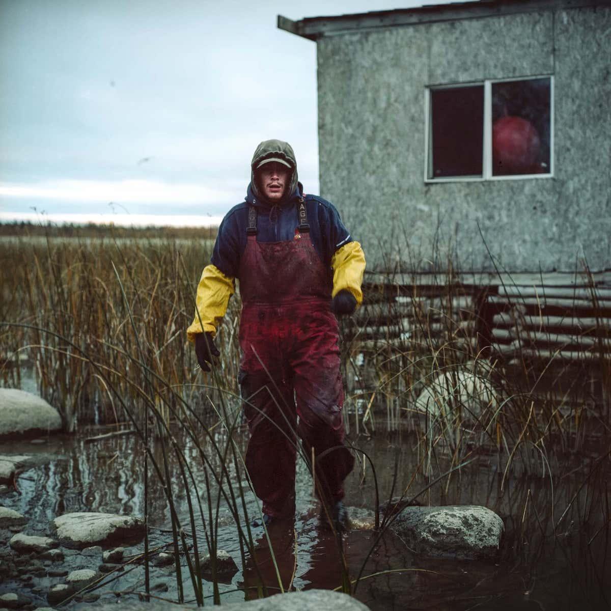 Fisherman's helper Murdock Saunders during his work day fishing