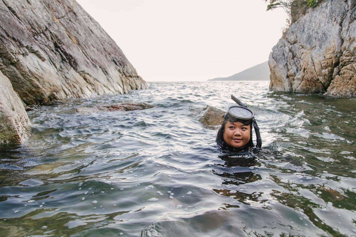 JennaMae Togado-Webb swims in the ocean before going free diving