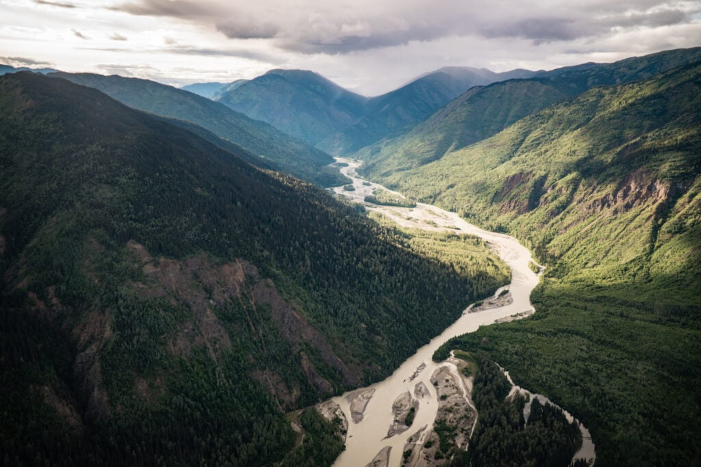 aerial view of boreal forest, mountains and river