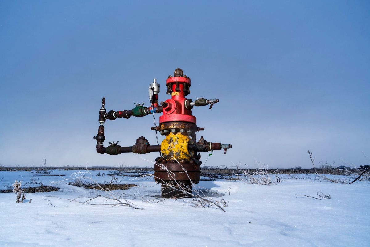 an oil and gas well is seen in the snow in Alberta